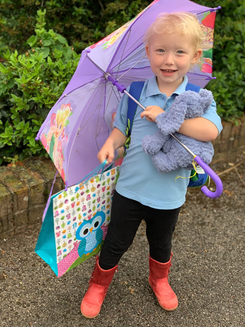 Child with an umbrella and gift bag