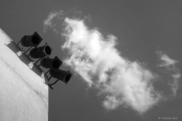 A Black and White Minimal Art Photograph of a Four Lights Versus The Cloud, shot at Jawahar Kala Kendra, Jaipur.