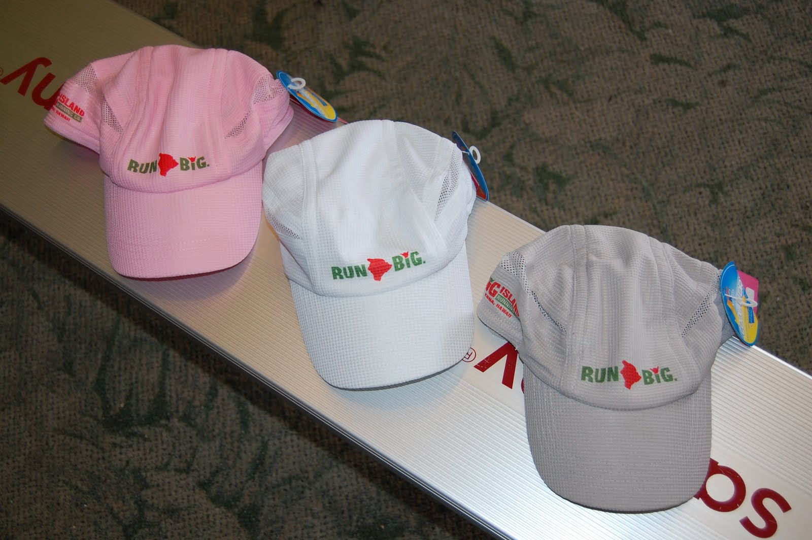These lightweight running hats are made by KC Caps with a moisture-wicking  fabric to keep you cool. They come in three colors - white 874a8b94518