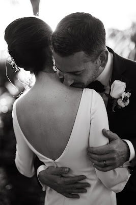 groom kisses brides shoulder
