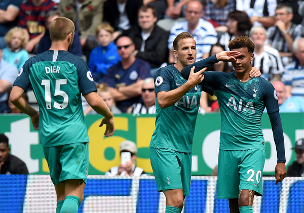 Dele Alli of Tottenham Hotspur celebrates with teammate Harry Kane after scoring his team's second goal during the Premier League match between Newcastle United and Tottenham Hotspur at St. James Park on August 11, 2018 in Newcastle upon Tyne, United Kingdom. (Aug. 10, 2018 - Source: Tony Marshall/Getty Images Europe)