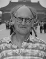 A black and white photo of Andrew Caldecott.