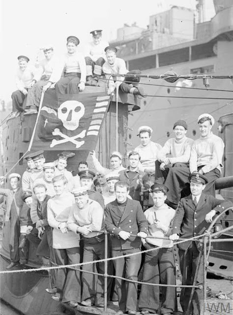 The crew of HMS UPRIGHT with their Jolly Roger Flag recording their successes, Holy Loch, 17 April 1942, www.filminspector.com