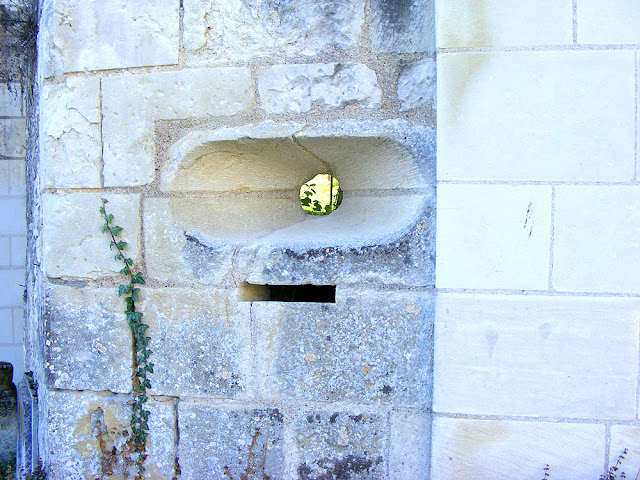 Gun port above the letterbox at the chateau, Crissay sur Manse, Indre et Loire, France. Photo by Loire Valley Time Travel.