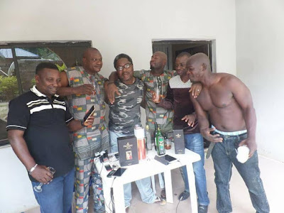 Photos: Fayose's aide, Lere Olayinka, drinks alcohol with his friends to celebrate Ali Modu Sheriff's defeat at the Supreme court