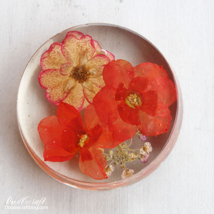 paperweights are jewelry for the desk--clear polyester resin with pressed flowers are beautiful