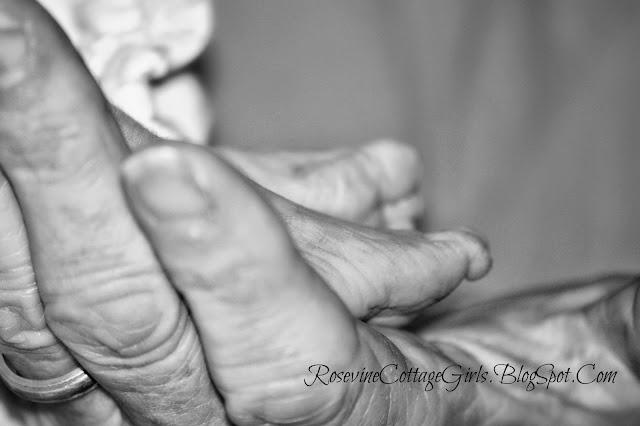 Trisomy 13 | newborn preemies feet in grandma's hands | rosevinecottagegirls.com | infant loss