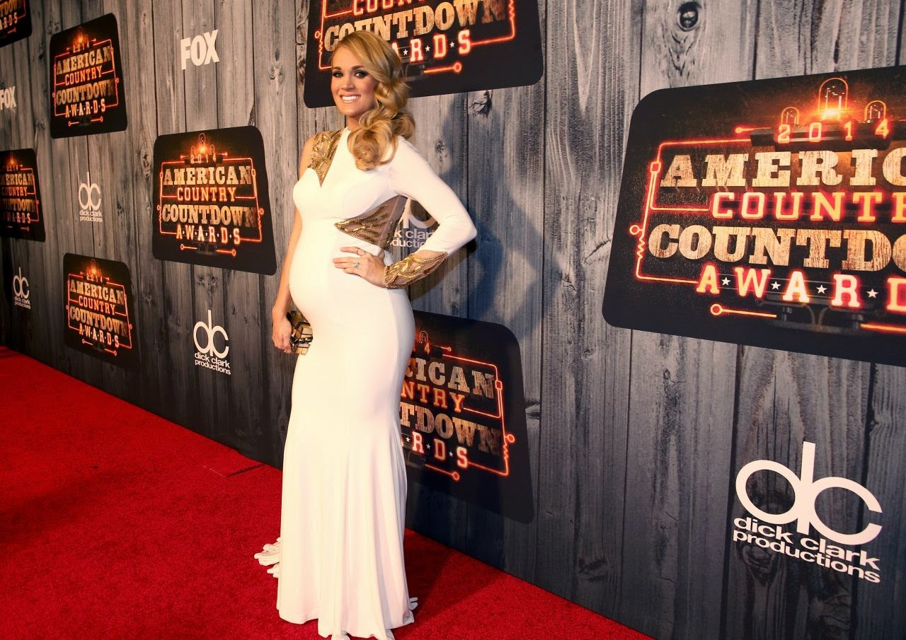 Carrie Underwood shows off baby bump at the 2014 American Country Countdown Awards in Nashville
