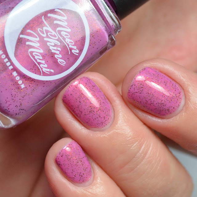 mauve nail polish with shimmer swatch