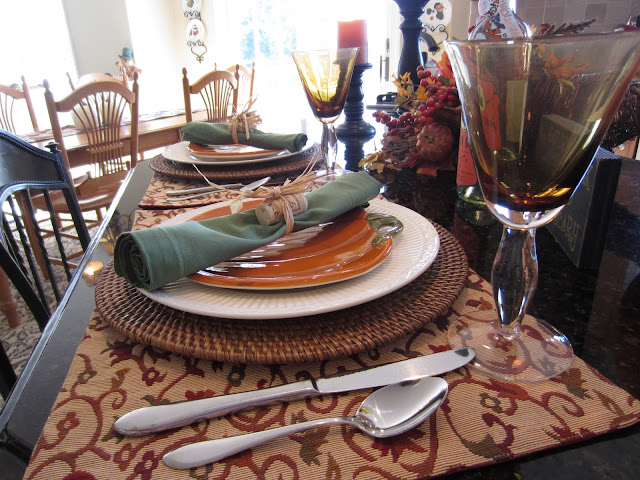 Halloween Table Setting - Fall colors and pumpkin plates make the table festive for the season.