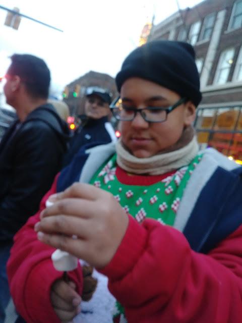 Roasting marshmallows at Wintertide Gordon Square