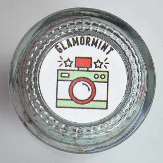 bottle bottom label with camera image and name