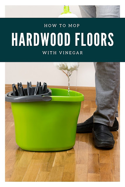 How to clean hardwood floors with vinegar. Cleaning naturally with vinegar is easy and helps keep the wood shiny. This simple recipe is good for stains, pets, and old houses. How to use vinegar and essential oils to mop your floor. This is the best way to keep your floors clean naturally with natural products.  Also includes how to deep clean wood floors. #woodfloors #hardwood #vinegar #natural