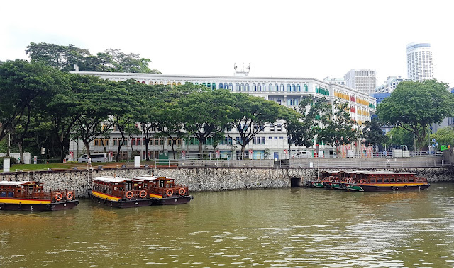 Clarke Quay - singapore river with some typical boats