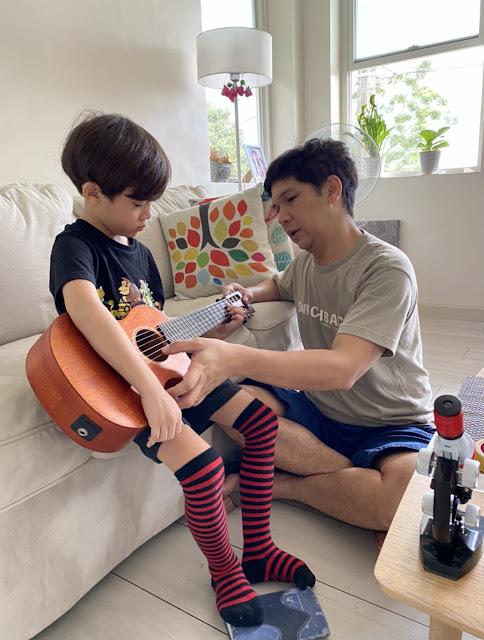 Mark Escueta and his son