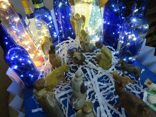 creche with lighted bottles