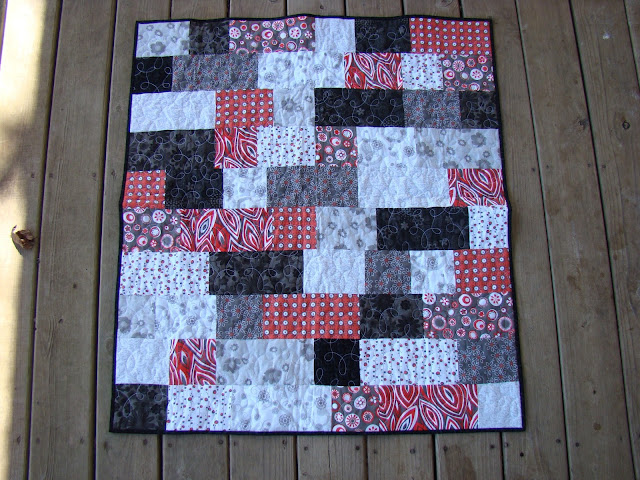 red and black bricks baby quilt