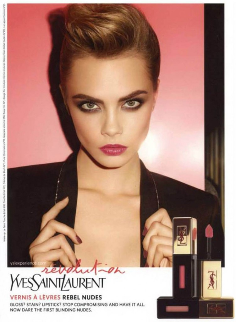 Cara Delevingne sports bold make up looks from the Yves Saint Laurent Spring 2014 collection