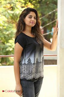 Actress Karuna Pictures in Jeans at Tholi Kiranam Press Meet  0041