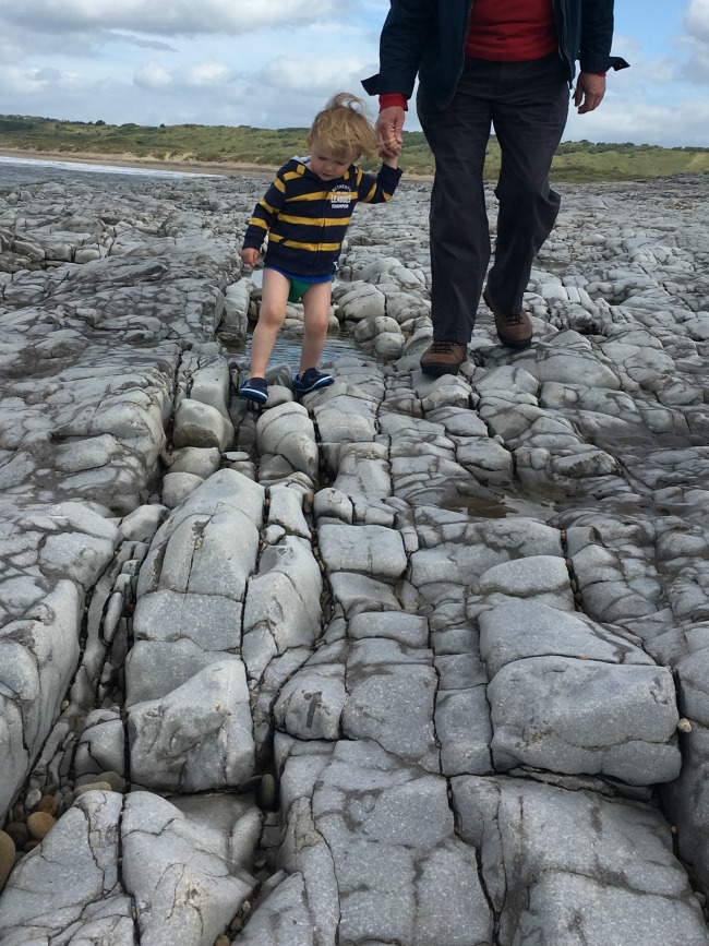 Ogmore-by-sea-a-toddler-explores-toddler-on-rocks