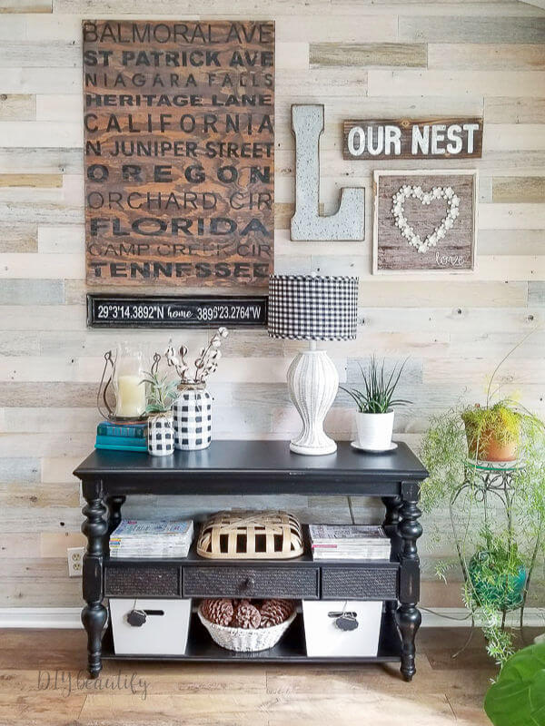 wood walls with black and white farmhouse decor