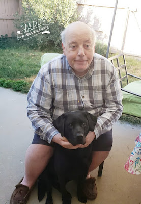 William, in check shirt and Leif a black labrador sit in our garden on November 2 2019. Their sixth anniversary after graduation from guide dog training.