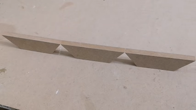 تجميع قطع خشبية مقصوصة بزاوية 36 درجة لعمل شكل خماسي