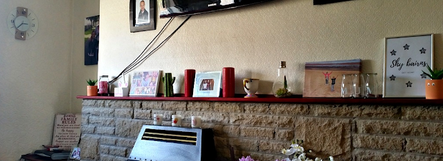 My fireplace with all the knick knacks, ornaments and photos on.
