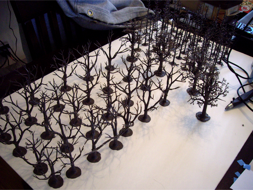 Woodland Scenics pine and deciduous tree armatures attached to a foamboard panel