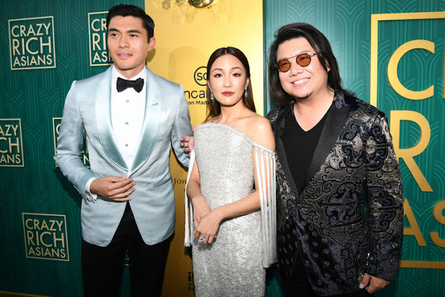 Henry Golding and Constance Wu on the Red Carpet with Kevin Kwan, the author of Crazy Rich Asians