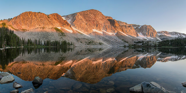 Sunrise reflection of Medicine Bow Peak in Lake Marie in the Snowy Range, Wyoming