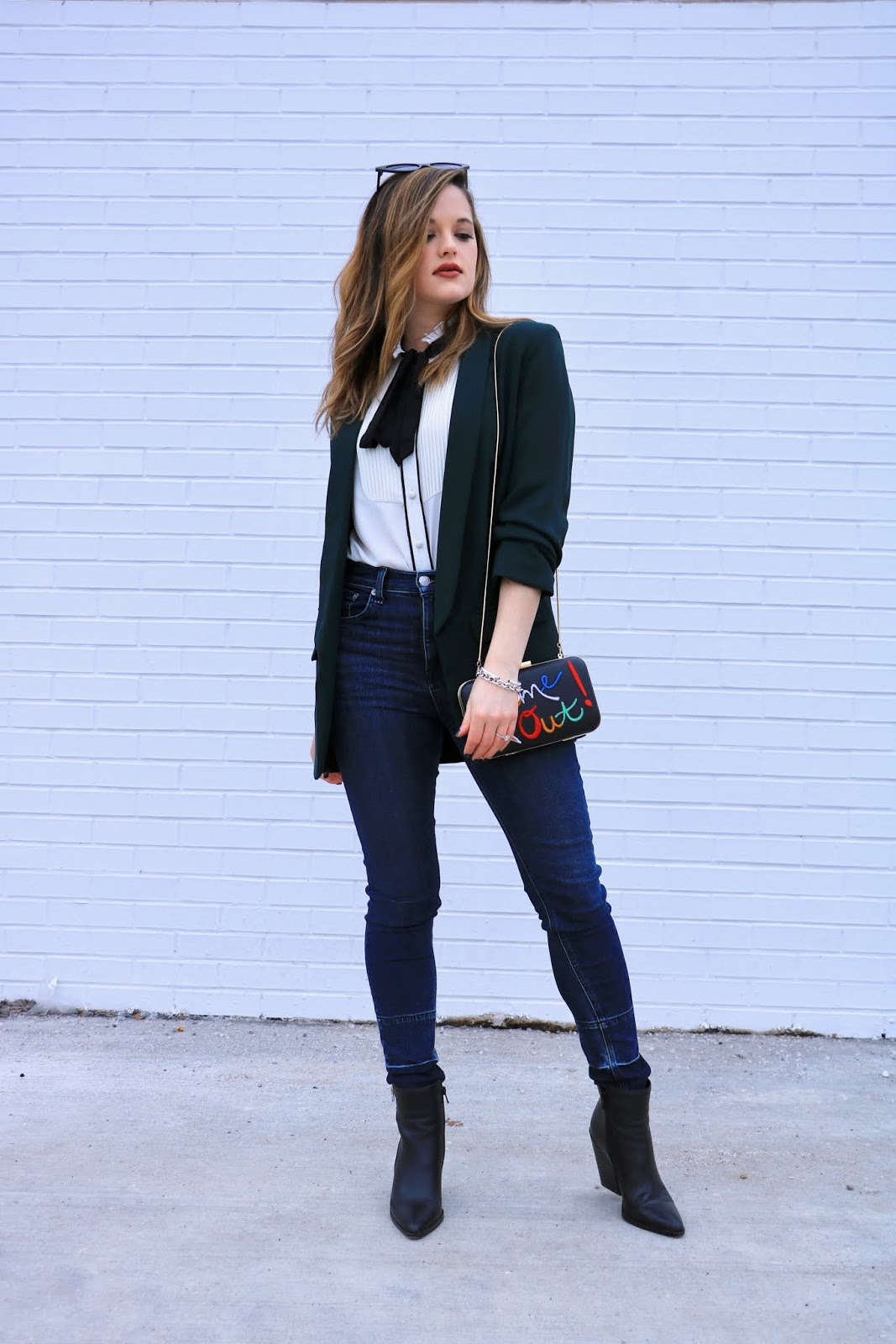 Nyc fashion blogger Kathleen Harper wearing a work outfit with jeans.