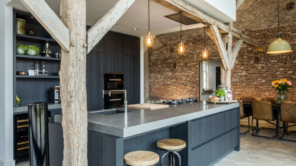 Beautiful rustic modern farmhouse kitchen with exposed brick in barn conversion