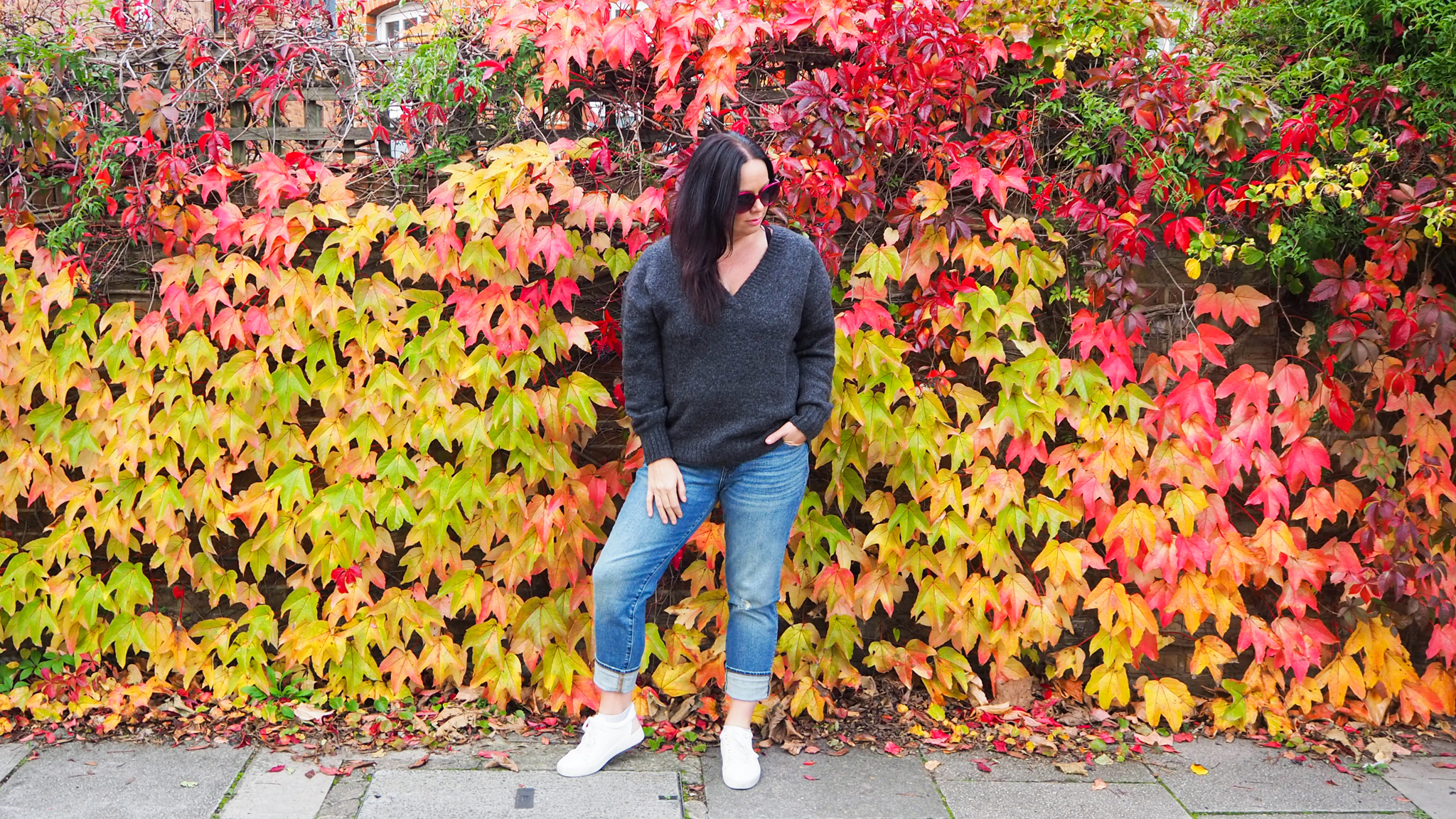 Gap Girlfriend Jeans, H&M Grey V-neck Jumper, Carvella White Trainers and colourful Autumn Leaves