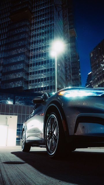 Wallpaper of car, headlights, buildings, front view