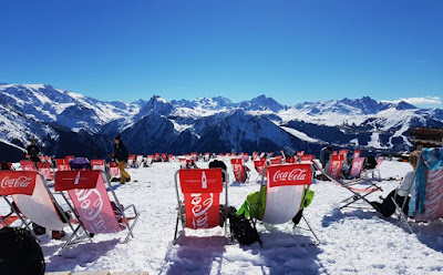 Deckchairs on snow with mountain view