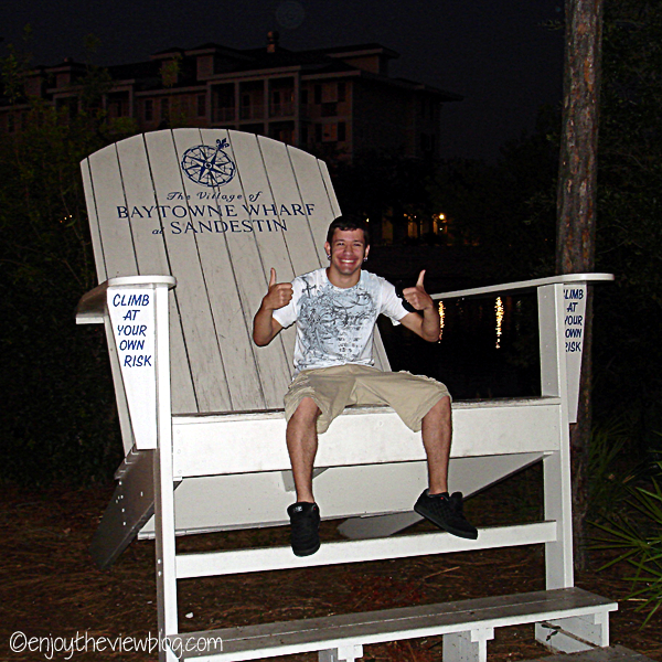 young man sitting in a huge chair