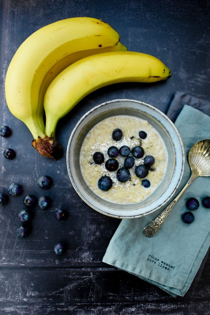 Creamy Blueberry, Banana and Coconut Porridge in a bowl topped with fresh blueberries