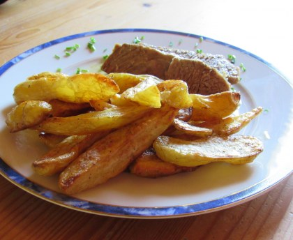 Oven-roasted potatoes in olive oil
