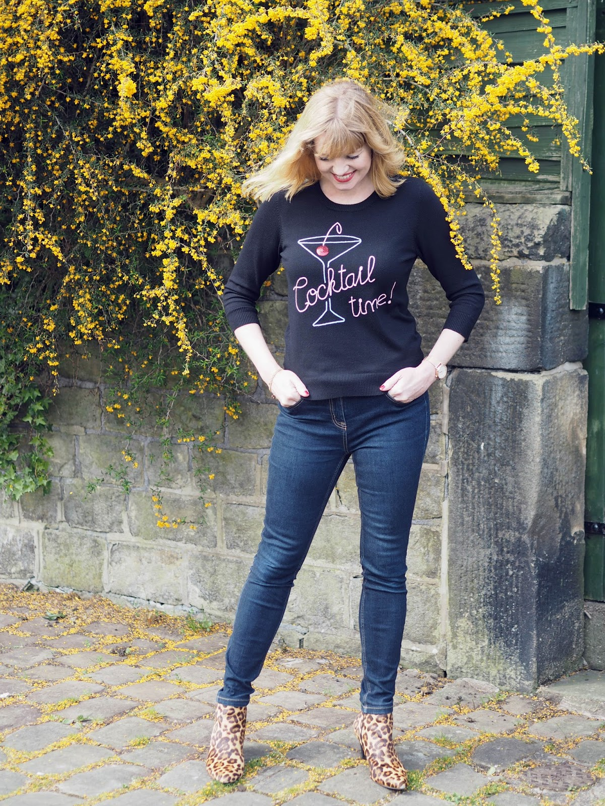 What Lizzy Loves. Cocktail glass logo top worn with skinny jeans and high-heeled leopard print ankle boots