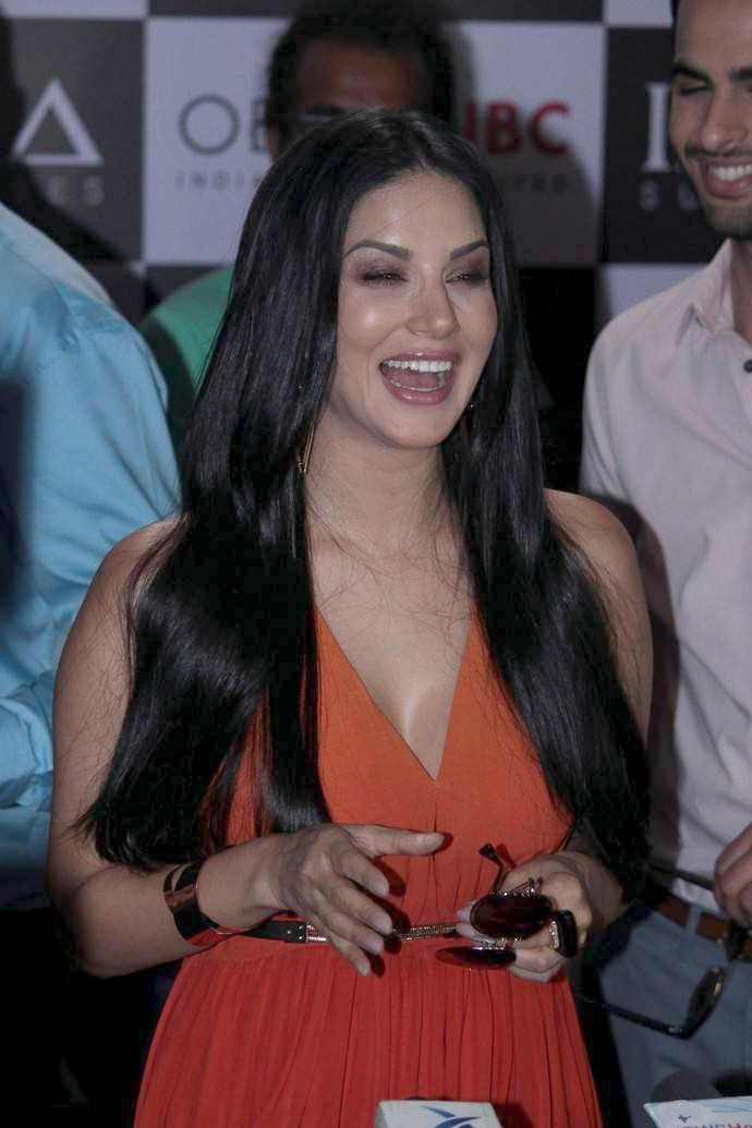 Sunny Leone Long Hair Stills In Orange Dress At Sunglasses Add Shoot