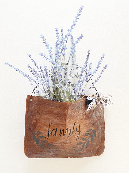leather look bag filled with flowers