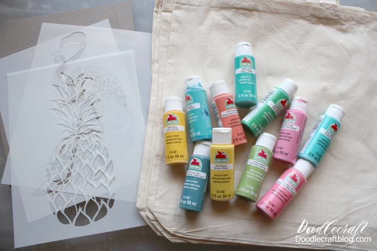 Supplies Needed for Stenciled Tropical Totes: Paint (Apple Barrel from Plaid Crafts) Tote bags (Organic Cotton from Totebag Factory) Cardboard to fit inside the tote bag Stenciling Brush or Sponge Brush Stencil Revolution Reusable Stencils (flamingo, pineapple, and peacock)