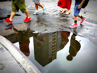 Family reflection in puddle