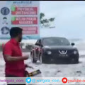 Warga Manado Dihebohkan Dengan Gelombang Air Laut Naik Hingga ke Permukaan Jalan