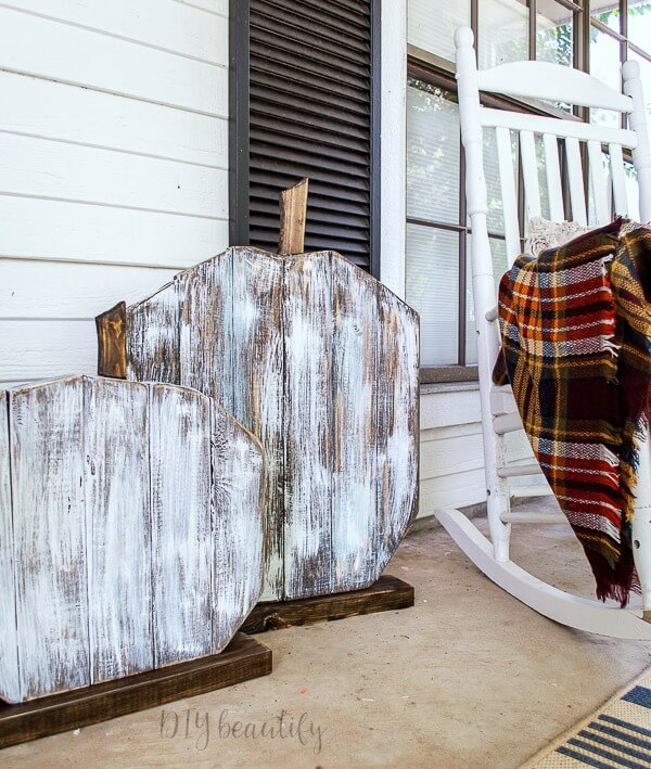 distressed 2x4 wood porch pumpkins
