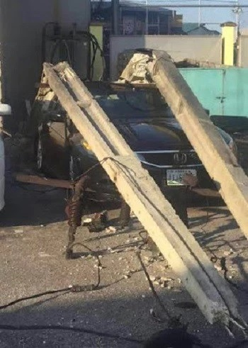 OMG!!! Many Escape Death as Electric Pole Falls and Smashes Car in Lagos (Photos)