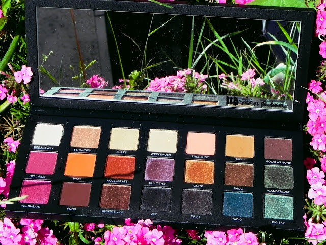 Urban decay born to run palette surrounded by pink flowers in the background