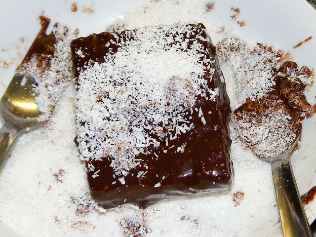 Coating a lamington with coconut. Photo by Loire Valley Time Travel.