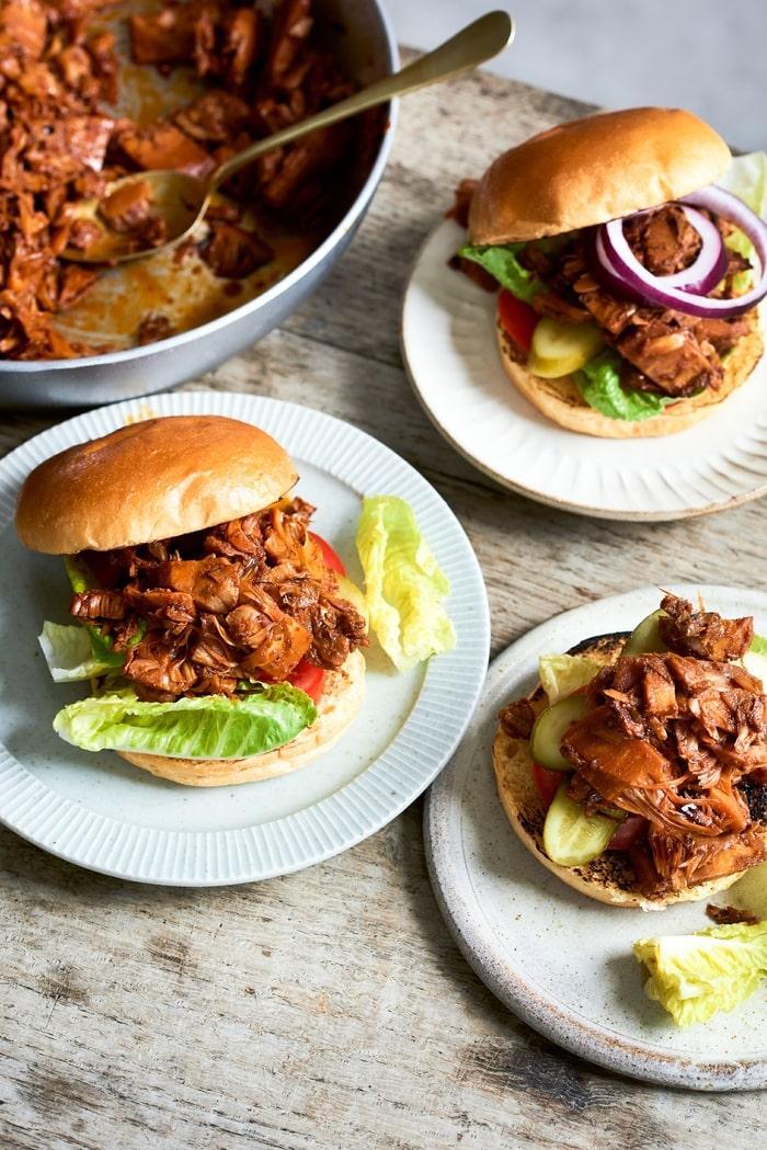 Vegan Pulled Jackfruit Burgers with salad on burger buns